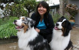 groomer-smiling-with-dogs